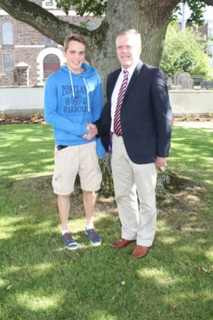 Headmaster Mr Skelton congratulates Michael White on his outstanding 10A*s at GCSE